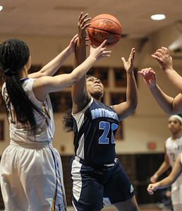January 25, 2019: Northwestern guard Ravin Hatcher (20) attempts to grab a rebound during high school girls basketball action between Northwestern HS and Laurel HS in Laurel. Photo by: Chris Thompkins/Prince Georges Sentinel
