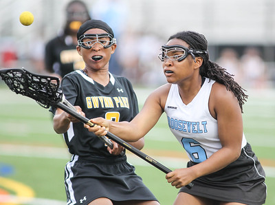 May 4, 2019: Roosevelt midfielder Lindsay Blocker (6) and Gwynn Park midfielder Alisa Evans (2) battles for a loose ball during PG County girls lacrosse championship between Gwynn Park HS and E. Roosevelt HS in Glen Dale. Photo by: Chris Thompkins/Prince Georges County Sentinel