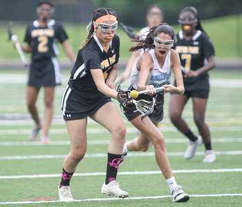 May 4, 2019: Roosevelt midfielder Camille Lorente (16) and Gwynn Park midfielder Edelyn Bobadilla (4) battles for a loose ball during PG County girls lacrosse championship between Gwynn Park HS and E. Roosevelt HS in Glen Dale. Photo by: Chris Thompkins/Prince Georges County Sentinel