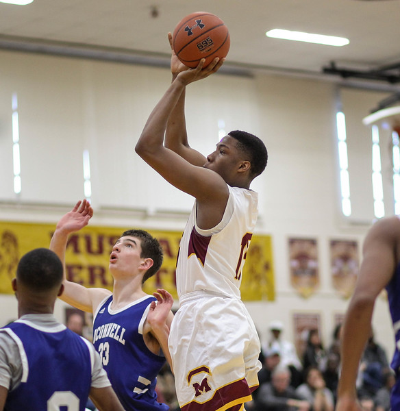 """February 2, 2019: McNamara forward Terrence Butler (15) shoots a jump shot over O'Connell defenders during HS boys basketball action between Bishop O'Connell HS and Bishop McNamara HS in Forestville. Photo by: Chris Thompkins/Prince George""""s Sentinel"""