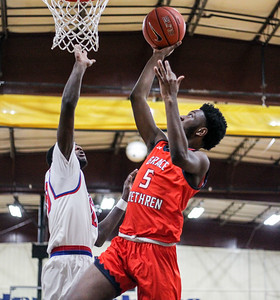January 11, 2020: Grace Brethren Israel Holloman (5) goes for an layup during HS boys basketball action between Grace Brethren Christian School and Friendly HS in Upper Marlboro, MD.  Photos by Chris Thompkins/Prince Georges Sentinel