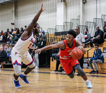 January 11, 2020: Grace Brethren Rayvon Wilkinson (4) dribbles past an Friendly defender during HS boys basketball action between Grace Brethren Christian School and Friendly HS in Upper Marlboro, MD.  Photos by Chris Thompkins/Prince Georges Sentinel