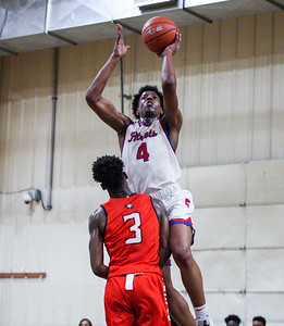 January 11, 2020: Friendly Mondahle Daniels (4) shoots over Grace Brethren Matthew Malone (3) during HS boys basketball action between Grace Brethren Christian School and Friendly HS in Upper Marlboro, MD. Photos by Chris Thompkins/Prince Georges Sentinel