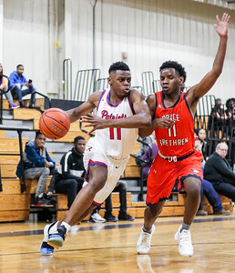 January 11, 2020: Friendly Jules Bikoy (11) drives past Grace Brethren Cedric Bell (11) during HS boys basketball action between Grace Brethren Christian School and Friendly HS in Upper Marlboro, MD.  Photos by Chris Thompkins/Prince Georges Sentinel