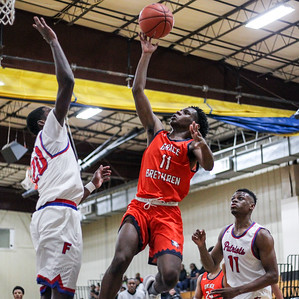 January 11, 2020: Grace Brethren Cedric Bell (11) goes for an layup past Friendly Derrick Brown (20) during HS boys basketball action between Grace Brethren Christian School and Friendly HS in Upper Marlboro, MD.  Photos by Chris Thompkins/Prince Georges Sentinel