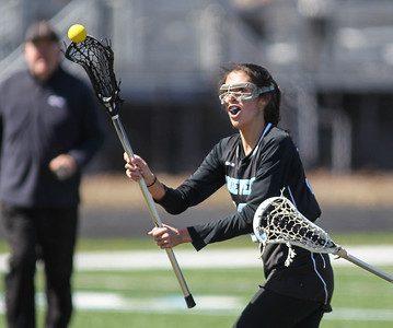 March 23, 2019: Roosevelt midfielder Camille Lorente (16) scores an goal during HS girls lacrosse action between E. Roosevelt HS and Northwestern HS in Hyattsville. Photo by: Chris Thompkins/Prince Georges Sentinel