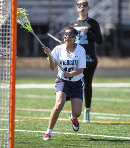 March 23, 2019: Northwestern attacker Carina Ruiz (16) scores a goal during HS girls lacrosse action between E. Roosevelt HS and Northwestern HS in Hyattsville. Photo by: Chris Thompkins/Prince Georges Sentinel