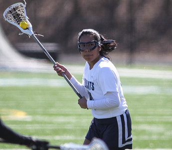 March 23, 2019: Northwestern midfielder Nataly Escobar (14) looks for an open teamate during HS girls lacrosse action between E. Roosevelt HS and Northwestern HS in Hyattsville. Photo by: Chris Thompkins/Prince Georges Sentinel