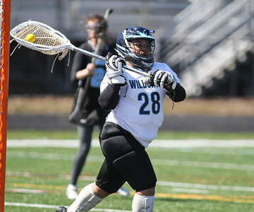 March 23, 2019: Northwestern goalie Melissa Soriano (28) passes the ball after making a save during HS girls lacrosse action between E. Roosevelt HS and Northwestern HS in Hyattsville. Photo by: Chris Thompkins/Prince Georges Sentinel