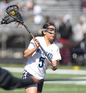 March 23, 2019: Northwestern midfielder Diana Zelaya (5) attempts a shot during HS girls lacrosse action between E. Roosevelt HS and Northwestern HS in Hyattsville. Photo by: Chris Thompkins/Prince Georges Sentinel