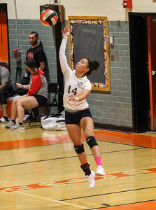 October 3, 2019: Northwestern Camila Cedeno (14) serves the ball during HS volleyball action between Northwestern HS and Duval HS in Lanham, MD. Photos by Chris Thompkins/Prince Georges Sentinel