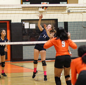 October 3, 2019: Northwestern Corrine Couch (12) hits the ball over the net during HS volleyball action between Northwestern HS and Duval HS in Lanham, MD. Photos by Chris Thompkins/Prince Georges Sentinel