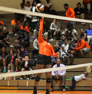 October 3, 2019: Duval Ellycia Smalley (4) tips the ball over the net during HS volleyball action between Northwestern HS and Duval HS in Lanham, MD. Photos by Chris Thompkins/Prince Georges Sentinel