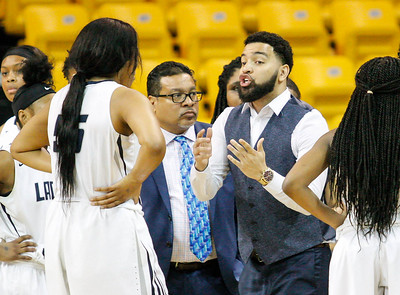March 15, 2019: Largo assistant coach Robert Pettis Jr talks with forward Billie Johnson (55) during MPSSAA girls basketball 1A Semifinal matchup between Pikesville HS and Largo HS in Towson. Photo by: Chris Thompkins/Prince Georges Sentinel
