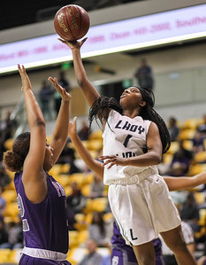 March 15, 2019: Largo guard Alexia Hackett (1) goes for a layup past Pikesville defender during MPSSAA girls basketball 1A Semifinal matchup between Pikesville HS and Largo HS in Towson. Photo by: Chris Thompkins/Prince Georges Sentinel