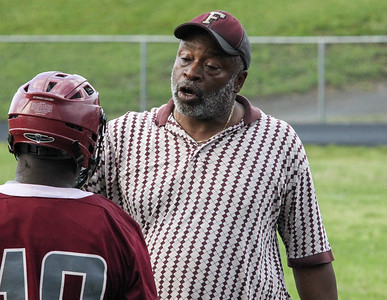 May 10, 2019: Fairmont Heights coach Bill Reaves talks to one of his players during MPSSAA 1A Boys lacrosse playoffs between Fairmont Heights HS and Largo HS in Largo. Photos by Chris Thompkins/ Prince Georges Sentinel