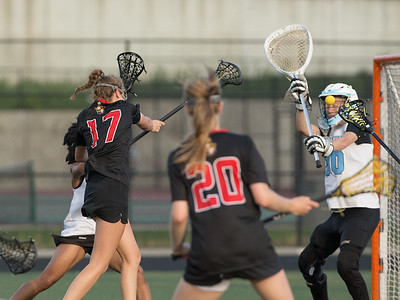 Audrey Dickens of Dulaney fires just past Eleanor Roosevelt Goalie Zosia Nicholson. Dulaney advances to the 4A finals against Severna Park. PHOTO BY MIKE CLARK