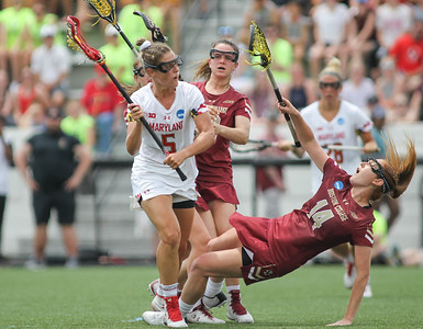 May 26, 2019: Maryland midfielder Jen Giles (5) and Boston College defender Jillian Reilly (14) collides during NCAA Womens Lacrosse Championship matchup between Boston College and University of Maryland in Baltimore. Photos by Chris Thompkins/Prince Georges Sentinel