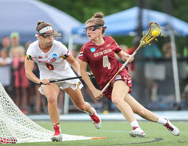 May 26, 2019: Boston College attacker Kenzie Kent (4) tries to get past Maryland defender Meghan Doherty (6) during NCAA Womens Lacrosse Championship matchup between Boston College and University of Maryland in Baltimore. Photos by Chris Thompkins/Prince Georges Sentinel