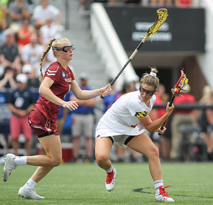 May 26, 2019: Maryland midfielder Jen Giles (5) dodges an Boston College defender during NCAA Womens Lacrosse Championship matchup between Boston College and University of Maryland in Baltimore. Photos by Chris Thompkins/Prince Georges Sentinel