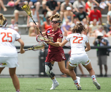 May 26, 2019: Boston College midfielder Cara Urbank (26) attempts a shot past Maryland defenders during NCAA Womens Lacrosse Championship matchup between Boston College and University of Maryland in Baltimore. Photos by Chris Thompkins/Prince Georges Sentinel