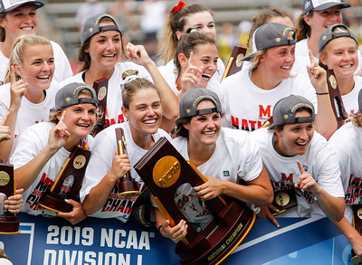 May 26, 2019: Maryland player pose with the championship trophy after NCAA Womens Lacrosse Championship matchup between Boston College and University of Maryland in Baltimore. Photos by Chris Thompkins/Prince Georges Sentinel