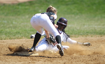 April6, 2019: McNamara second basemen Tay-Lor Albright (42) steals second base against St Johns shortstop Alexis Bruce (13) during HS girls softball action between St Johns College HS and Bishop McNamara HS in Forestville. Photo by: Chris Thompkins/Prince Georges Sentinel