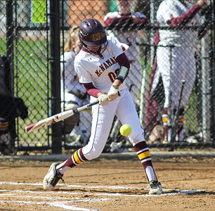 April6, 2019: McNamara second baseman MaKayla Marbury (00) hits the ball during HS girls softball action between St Johns College HS and Bishop McNamara HS in Forestville. Photo by: Chris Thompkins/Prince Georges Senitnel