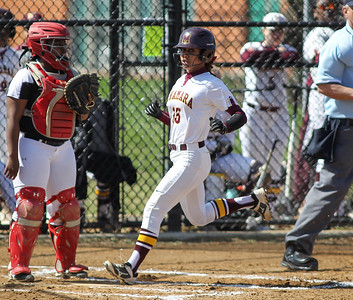 April6, 2019: McNamara shortstop Jade Geene (15) scores a run during HS girls softball action between St Johns College HS and Bishop McNamara HS in Forestville. Photo by: Chris Thompkins/Prince Georges Sentinel