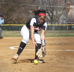 April6, 2019: St Johns pitcher Raye Thomas (14) scoops a ground ball during HS girls softball action between St Johns College HS and Bishop McNamara HS in Forestville. Photo by: Chris Thompkins/Prince Georges Sentinel