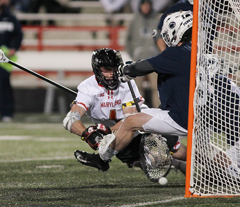 March 31, 2019: Maryland attackman Jared Bernhardt (1) scores a diving goal against Penn State defenders during NCAA Mens lacrosse action between Penn State and the University of Maryland in College Park. Photo by: Chris Thompkins/Prince Georges Sentinel
