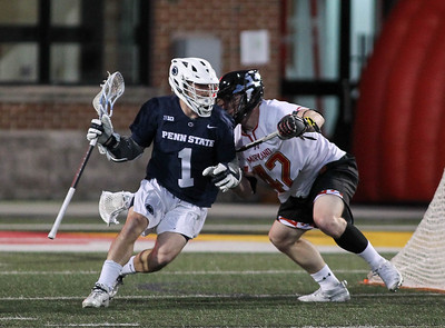 March 31, 2019: Penn State attackmen Grant Ament (1) tries to get past Maryland defender Curtis Corley (42) during NCAA Mens lacrosse action between Penn State and the University of Maryland in College Park. Photo by: Chris Thompkins/Prince Georges Sentinel