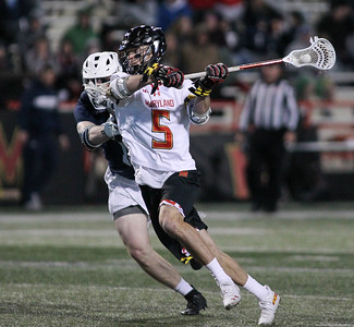 March 31, 2019: Maryland midfielder Will Snider (5) attempts a shot past an Penn State defender during NCAA Mens lacrosse action between Penn State and the University of Maryland in College Park. Photo by: Chris Thompkins/Prince Georges Sentinel