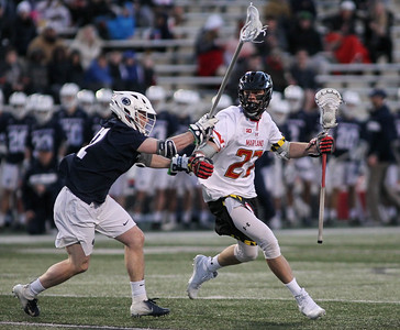 March 31, 2019: Maryland Christian Zawadzki (27) runs past Penn State defender Dean Lamela (32) during NCAA Mens lacrosse action between Penn State and the University of Maryland in College Park. Photo by: Chris Thompkins/Prince Georges Sentinel