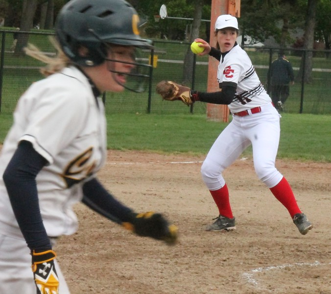 Divine Child's Sidney Croskey makes the play in the opener. Cabrini and host Divine Child split a doubleheader on Tuesday, May 2, 2017. (MiPrepZone photo gallery by Terry Jacoby)