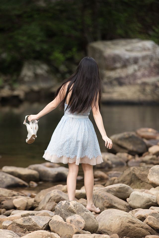 Chattanooga Senior Portraits - girl walking on rocks at a creek