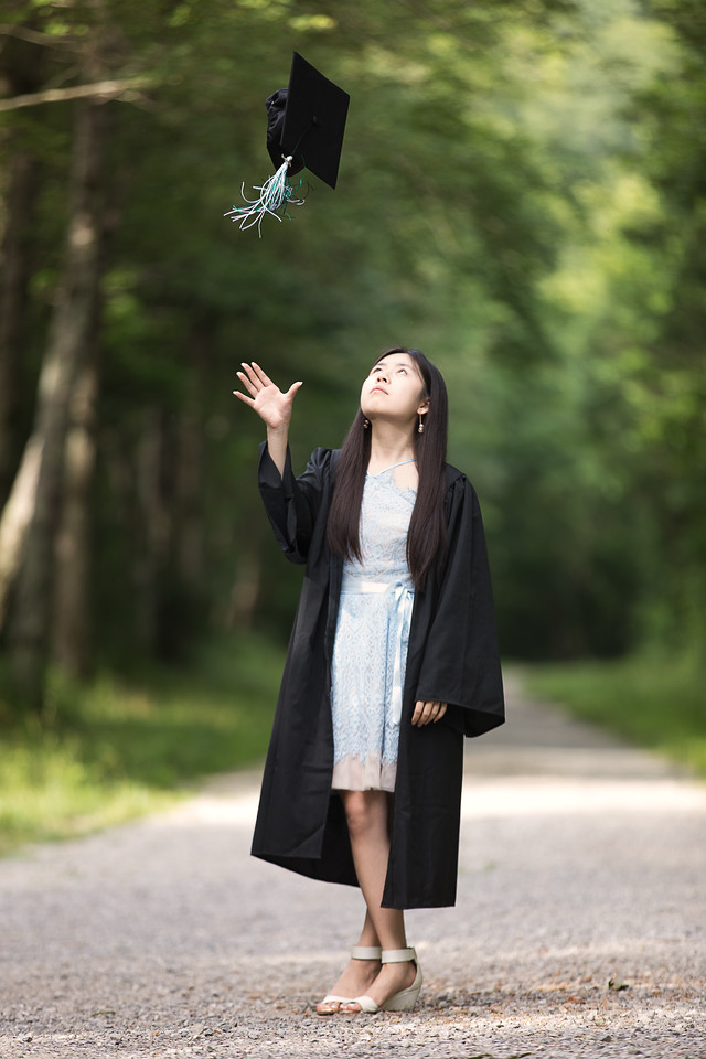High School Senior girl throwing her cap