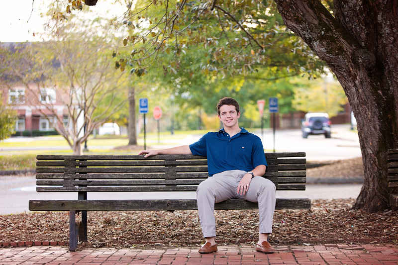 Senior boy sitting on bench at Baylor School Campus