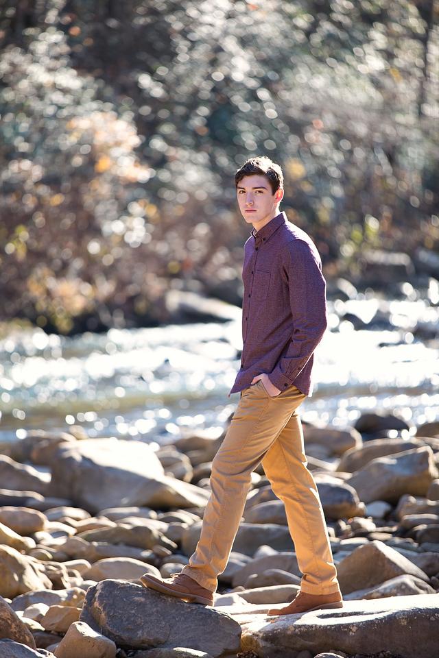 Boy at creek for Baylor School Senior Photos