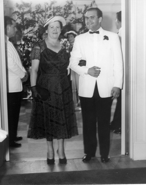 Sam Adler, brother of the bride, escorting his mother, Selma