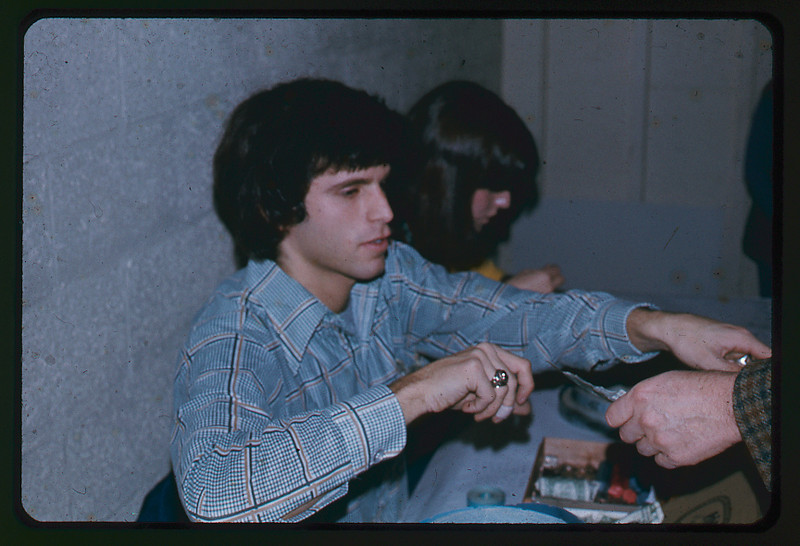 Curtis Krechevsky, collecting money for an evening event of the West Hartford Temple Youth of Temple Beth Israel, West Hartford, CT. This image was likely taken during January or February 1974.
