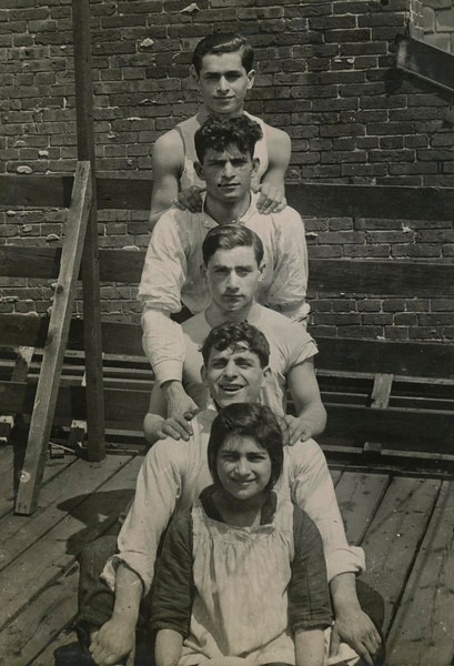 Four Brothers and a sister, with one brother and one sister not depicted. <br /> From Top to Bottom: Barnie, Louie, Max, Hymie, Anna, perhaps 1915.