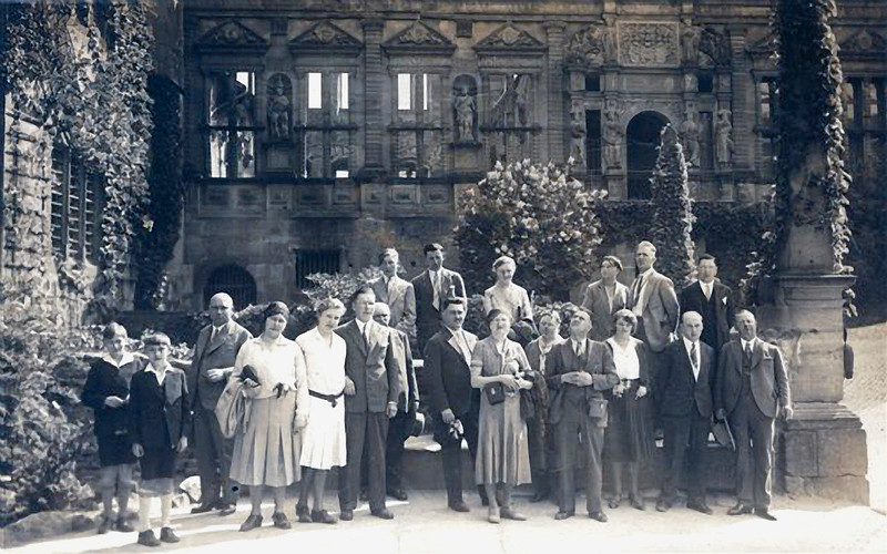 "RS036 | This was apparently a tour of the castle ruins in Heidelberg (1931), the shot randomly taken of those who happened to be touring that day.  The exact location is part of the ""Pharmacy Museum"" within the Schloss.  The man standing in the center is Kurt Rothschild (father of Edna [Rothschild] Azrieli.  Note the attire of the tourists and consider what a random crowd gathered at this very same Schloss would look like today."