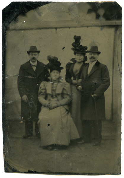 "RS008| This is the current state of the ""original"" image of Ernestine Sohn and her husband, Solomon Lehman (left couple) and Rosa Sohn and Leopold Rothschild. in February 1900.  The sisters were married in a joint ceremony.  This is a ""tintype"" print.  It is essentially a non-reflective photograph that was developed on a piece of tin (or iron), after which a dark enamel was applied.  Besides being very dark, the image has numerous scratches that are so deep they brazed the image itself.  This method was invented in 1856 and was used into the early part of the 20th century as an inexpensive method for reproducing images.  The image, partially restored, follows."