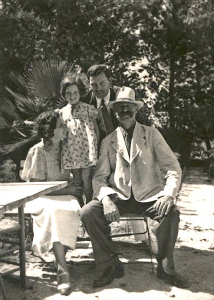 "RS037 | Hermann Rothschild, with his children, Kurt [in Israel, known as ""Dave""] standing, and little Anni standing on chair, with Paula, seated.  The photo was taken in Palestine, 1936."