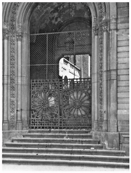 Entry gate to the Mannheim Hauptsynagoge, F2, 13/15.  The roof collapsed during the violence of Kristallnacht (November 9-10, 1938), hence you can see daylight as you look through the front portal.  Photographer unknown.  Photo was in the possession of my grandfather, Hugo Chaim Adler, who served the synagogue from the early 1920s until its destruction.<br /> <br /> The key depicted in the header of this page is the key to this main gate.  It was in the possession of my grandfather, Hugo Chaim Adler, upon departing Mannheim in 1939.