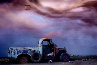 Abandoned truck.  The truck was found in an alleyway in Berkeley, left by this cement block wall.  I added a photo of the sky taken at dusk (in Reno).
