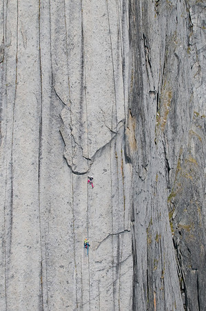 Lisi Steurer and Inis Papert free climbing the Lotus Flower Tower. The Lotus Flower Tower is one of North America's best big rock wall free climbs. The Cirque of Unclimbables, a circle of granite walls, is a rock climbing mecca which draws climbers from all over the world.