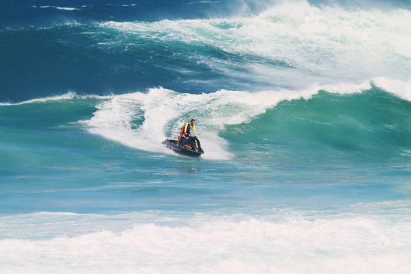 DEC 23 2012  Help is on the way, Windsurfer down with a broken sail in 11-16Ft waves at Ho'okipa Maui, Hi
