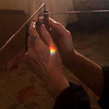 """This is a very significant picture taken of my hands, by my friend, on the evening of June 23, 2019. I was sitting on the floor in my living room and working with my dowsing rods, when I saw this rainbow appear on my left hand. I asked my friend to take a picture and we watched as the rainbow vibrated on my hand and then disappeared. We noted the time at 7:17 p.m. My friend and I were both born on the 7th day, so the time reflects two 7s. <br /> <br /> In numerology, my chart is dominated by the number 7 and this number is considered """"the seeker, the thinker, the searcher of Truth (notice the capital """"T""""). The 7 doesn't take anything at face value for it is always trying to understand the underlying, hidden truths. The 7 knows that nothing is exactly as it seems and that reality is often hidden behind illusions."""" How true these words are about me!<br /> <br /> Also, note the position of the dowsing rods as one rod is pointing to me and one rod is pointing to my friend as he is taking the picture, which symbolizes, """"We Are One."""" <br /> <br /> The first time I ever picked up a pair of dowsing rods, was in front of my Jesus statue, and one rod pointed to the statue and one rod swung backwards and pointed to me. It took me some time before I understood that this was Spirits way of communicating to me, """"We Are One.""""<br /> <br /> Finally, my friend taking this picture is the same friend who witnessed The Lights in the sky with me on the evening of July 22, 2019. This 30 minute experience can be viewed in the gallery, """"The Lights in the Sky."""""""
